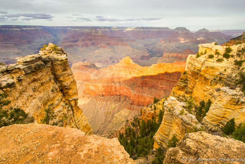 Take a close look at the ledge in upper right.  The people on the ledge give you a sense of how grand the Grand Canyon really is.